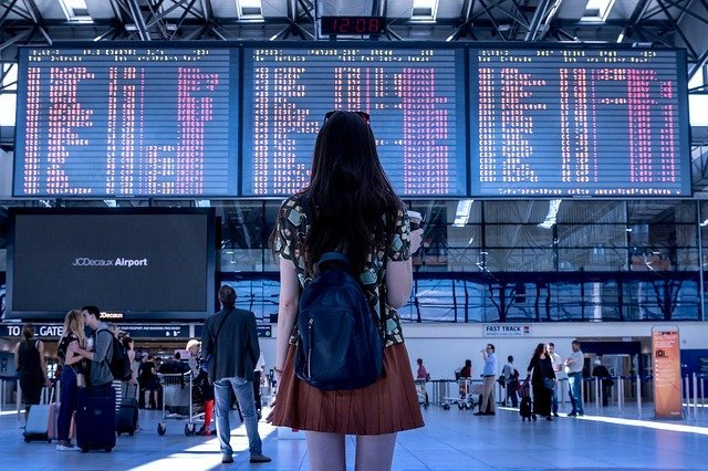 Traveller checking live flight Departures in Airport