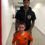 Charlie from Junction 21 with Man United's Marcus Rashford MBE